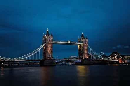 architecture bridge buildings calm waters